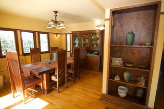 A Rare Lloyd Wright Prairie Home in L.A. Wants $1.35M - Photo 6 of 10 - The dining room with period-appropriate light fixtures