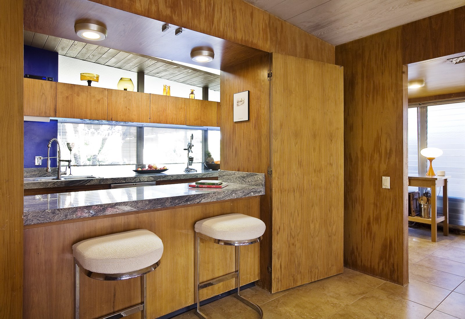 Bar seating by the kitchen.