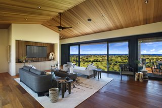 A Breezy Hawaiian Residence by Olson Kundig Hits the Market at $6.95M - Photo 3 of 14 - High ceilings with ceiling fans in the great room makes for bright and breezy interiors.