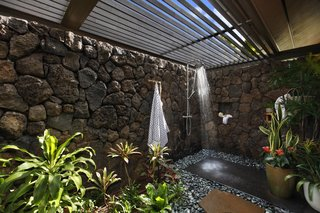 A Breezy Hawaiian Residence by Olson Kundig Hits the Market at $6.95M - Photo 12 of 14 - The garden shower features some of the region's native fauna.