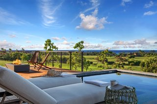 A Breezy Hawaiian Residence by Olson Kundig Hits the Market at $6.95M - Photo 10 of 14 - There is also a poolside fire pit on the terrace overlooking the ocean.