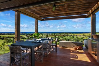 A Breezy Hawaiian Residence by Olson Kundig Hits the Market at $6.95M - Photo 9 of 14 - A covered exterior dining area around the pool