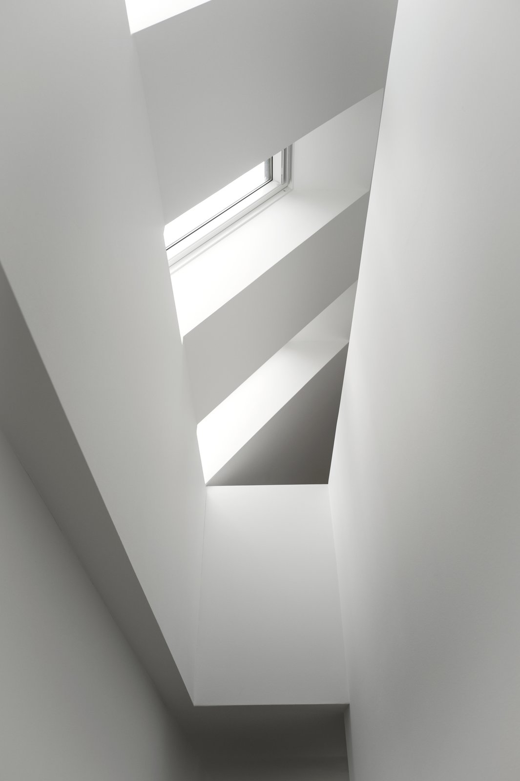 Skylights flooding the staircase in natural daylight and increasing the sense of height in the house. Tagged: Windows and Skylight.  Best Windows Photos from The Historic Villa Once Home to Poul Henningsen Receives a Modern Renovation