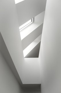 The Historic Villa Once Home to Poul Henningsen Receives a Modern Renovation - Photo 8 of 12 - Skylights flood the staircase in natural daylight and increases the sense of height in the house.
