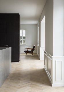 The Historic Villa Once Home to Poul Henningsen Receives a Modern Renovation - Photo 3 of 12 - Classic moldings were preserved, adding a historic flavor, while playing off sleek, contemporary touches.