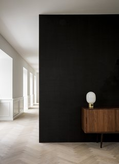 The Historic Villa Once Home to Poul Henningsen Receives a Modern Renovation - Photo 4 of 12 - With natural lighting entering from every angle, each room of the house is now bright and airy. The interiors feature an elegant play of light and dark.