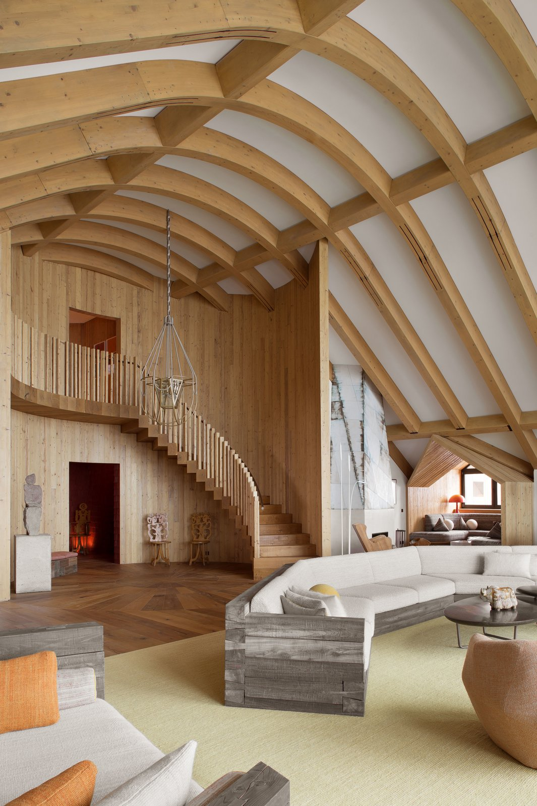 Matali Crasset's Lanterne suspension fixture in the spruce-paneled stairwell was originally created for a French cathedral.