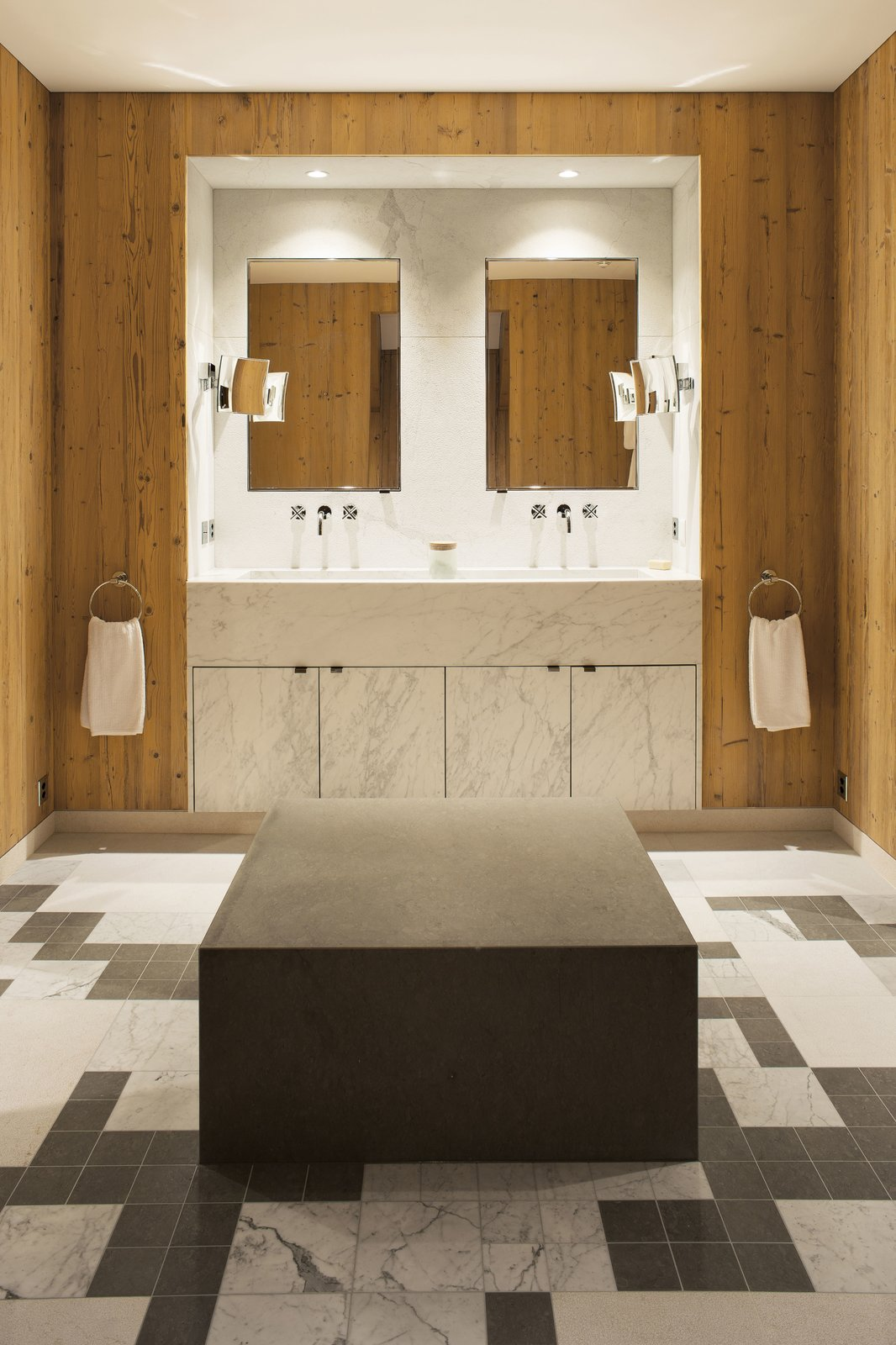 The master bathroom's features a custom-made bench and marble mosaic flooring.