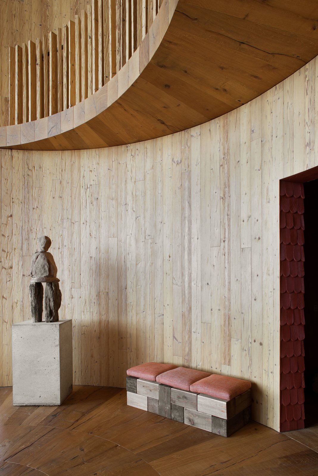 Swiss artist Ugo Rondinone's stone sculpture is displayed in the entry.