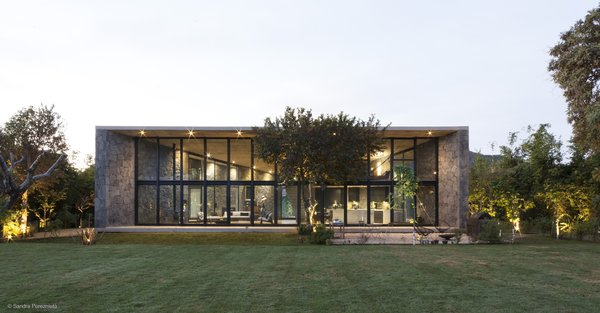 The roof is continuous and rests on top of the structural stone walls.