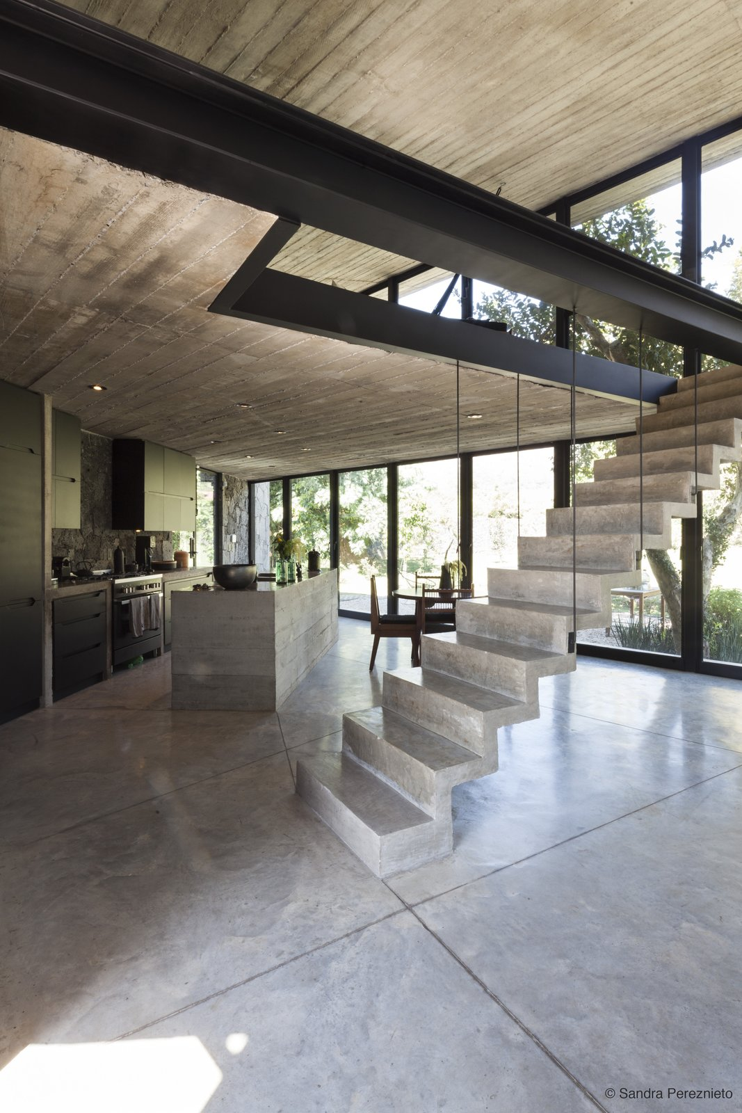 The main living area features a full glass frontage facing the mountains and stairs lead Tagged: Staircase and Concrete.  Best Staircase Photos from A Commanding Mexican Home of Stone and Concrete Is For Sale