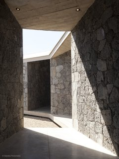 A Commanding Mexican Home of Stone and Concrete Is For Sale - Photo 7 of 10 - The diagonal patios and sloping roof create angular shadows.