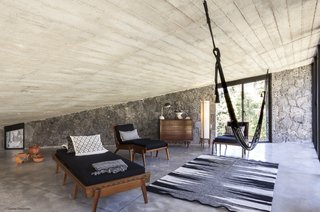A Commanding Mexican Home of Stone and Concrete Is For Sale - Photo 4 of 10 - The mezzanine level provides a relaxing space for lounging.