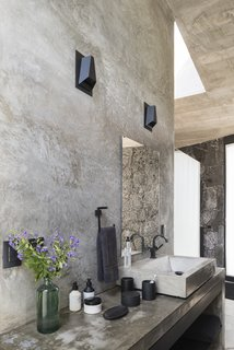 A Commanding Mexican Home of Stone and Concrete Is For Sale - Photo 6 of 10 - The raw materiality of the interiors is reflected in one of the bathrooms.