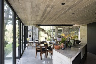 A Commanding Mexican Home of Stone and Concrete Is For Sale - Photo 1 of 10 - The home is an alternating series of open and enclosed spaces with ample glazing that provides plenty of natural light.