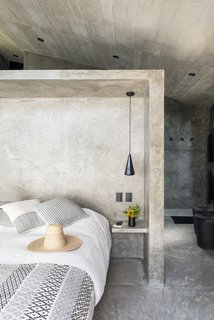 A Commanding Mexican Home of Stone and Concrete Is For Sale - Photo 5 of 10 - The bedroom is a good example of the minimal interiors featured throughout.