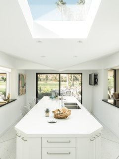 Own William Krisel's Palm Springs Pod House For $2.5M - Photo 12 of 18 - The kitchen is bright and airy thanks to a skylight.