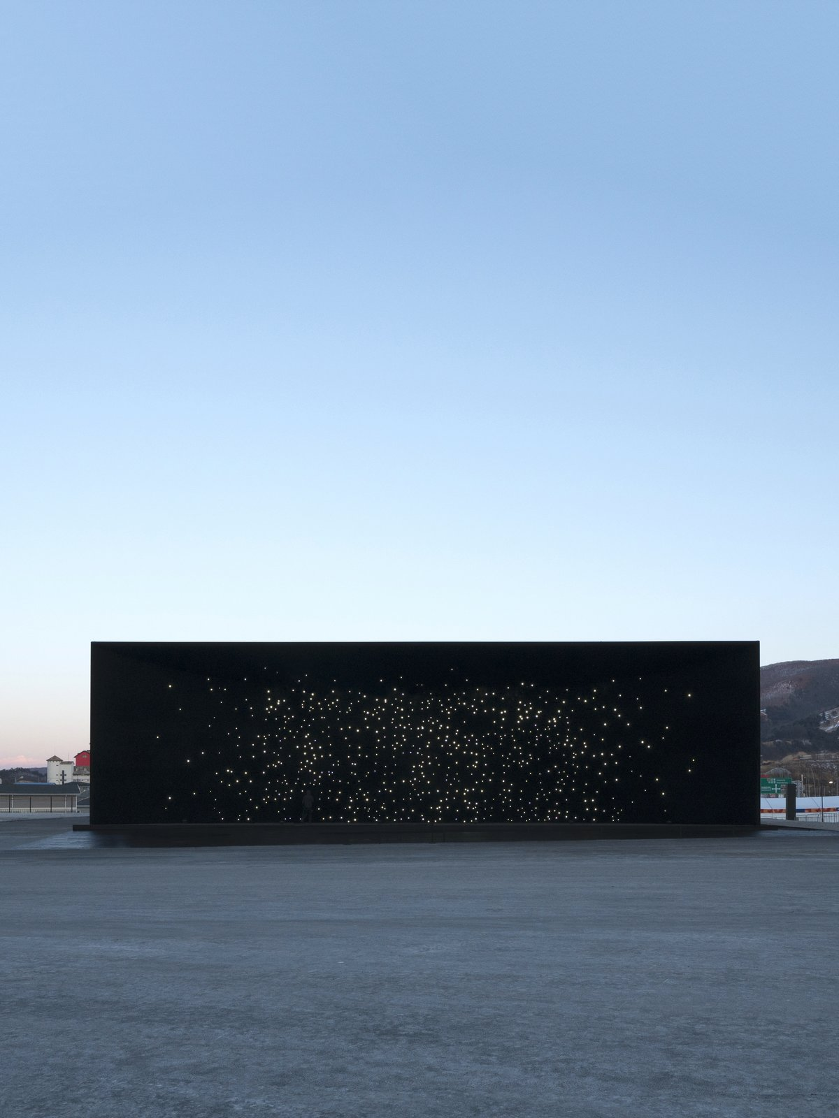 From a distance, the structure has the appearance of a window looking into the depths of outer space.