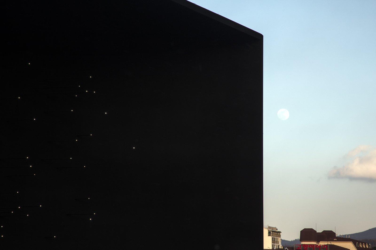 The black façade represents the Universe – the origin of Hydrogen.