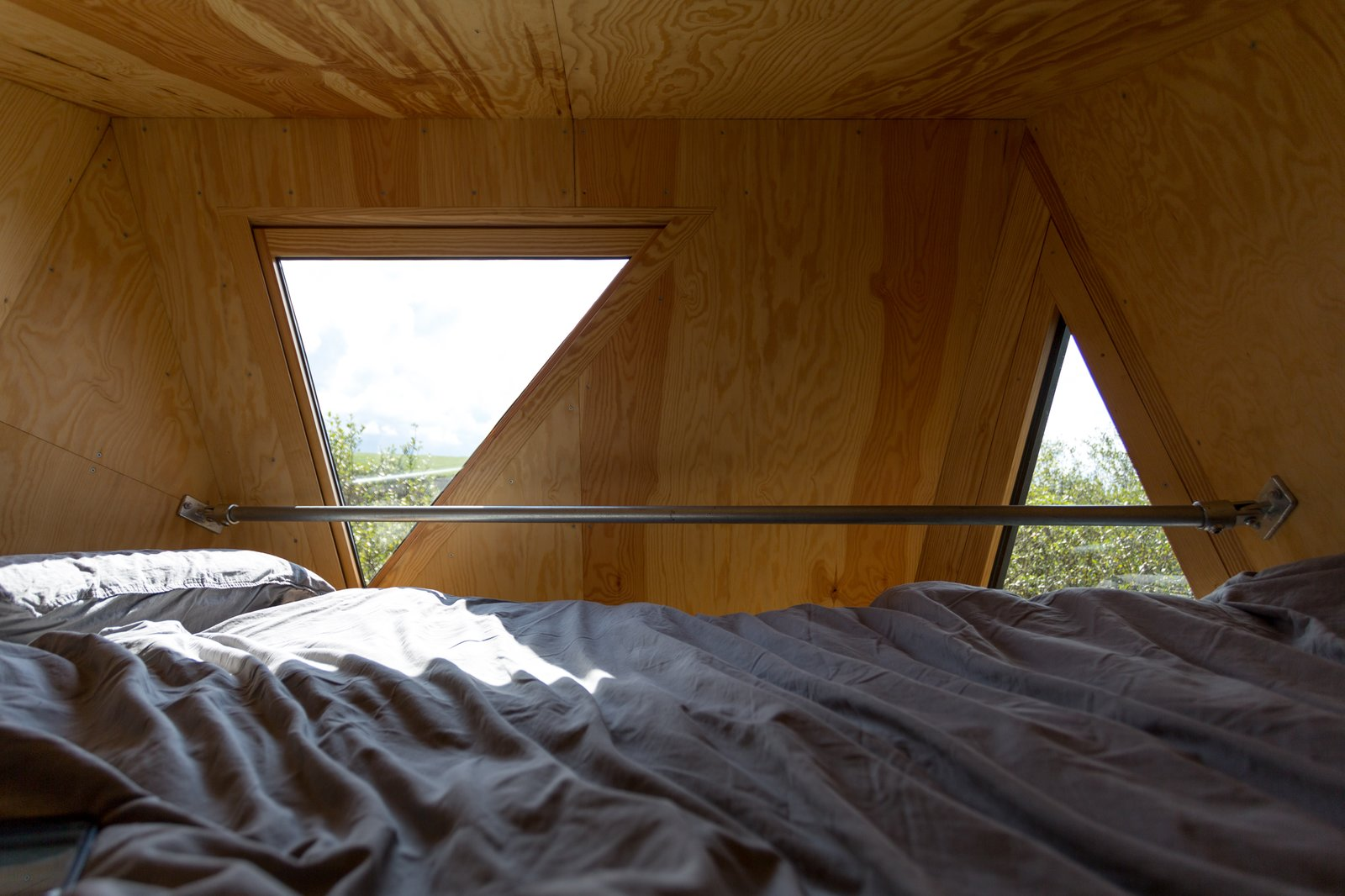 Small triangular windows allow for views of the Cornish countryside.