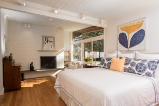 Own an Iconic Midcentury in New Canaan For $1.55M - Photo 10 of 12 - Along with the bright, airy setting, the master bedroom also features a fireplace.