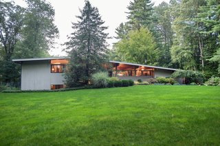 Own an Iconic Midcentury in New Canaan For $1.55M - Photo 1 of 12 - This beautiful home is set on three acres in the iconic enclave of New Canaan, Connecticut.