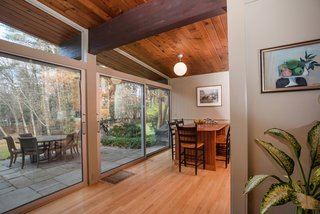 Own an Iconic Midcentury in New Canaan For $1.55M - Photo 7 of 12 - This corner could be an additional dining area, as well as a quiet reading nook.
