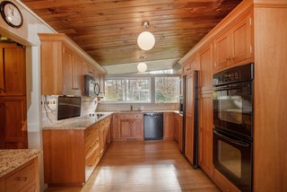 Own an Iconic Midcentury in New Canaan For $1.55M - Photo 8 of 12 - The kitchen also has plenty of stunning cabinetry, providing great storage space.