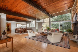 Own an Iconic Midcentury in New Canaan For $1.55M - Photo 4 of 12 - As you can see above, the living and dining area offers plenty of space for entertaining.