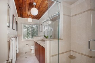 Own an Iconic Midcentury in New Canaan For $1.55M - Photo 11 of 12 - Here is a peek at one of the bathrooms.