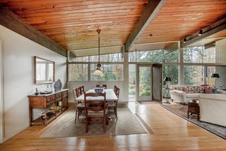 Own an Iconic Midcentury in New Canaan For $1.55M - Photo 3 of 12 - The open-plan living areaallows for multiple configurations.