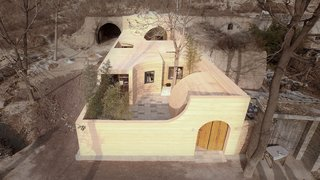 An Old Cave Dwelling in Central China Is Transformed Into a Stylish Home - Photo 20 of 26 - In front of the cave entrance is a new semi-curved canopy that is used to prevent the strong wind from Northwestern Mongolia.
