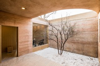 An Old Cave Dwelling in Central China Is Transformed Into a Stylish Home - Photo 16 of 26 - Smaller courtyards connect the southern-facing volumes of the home.