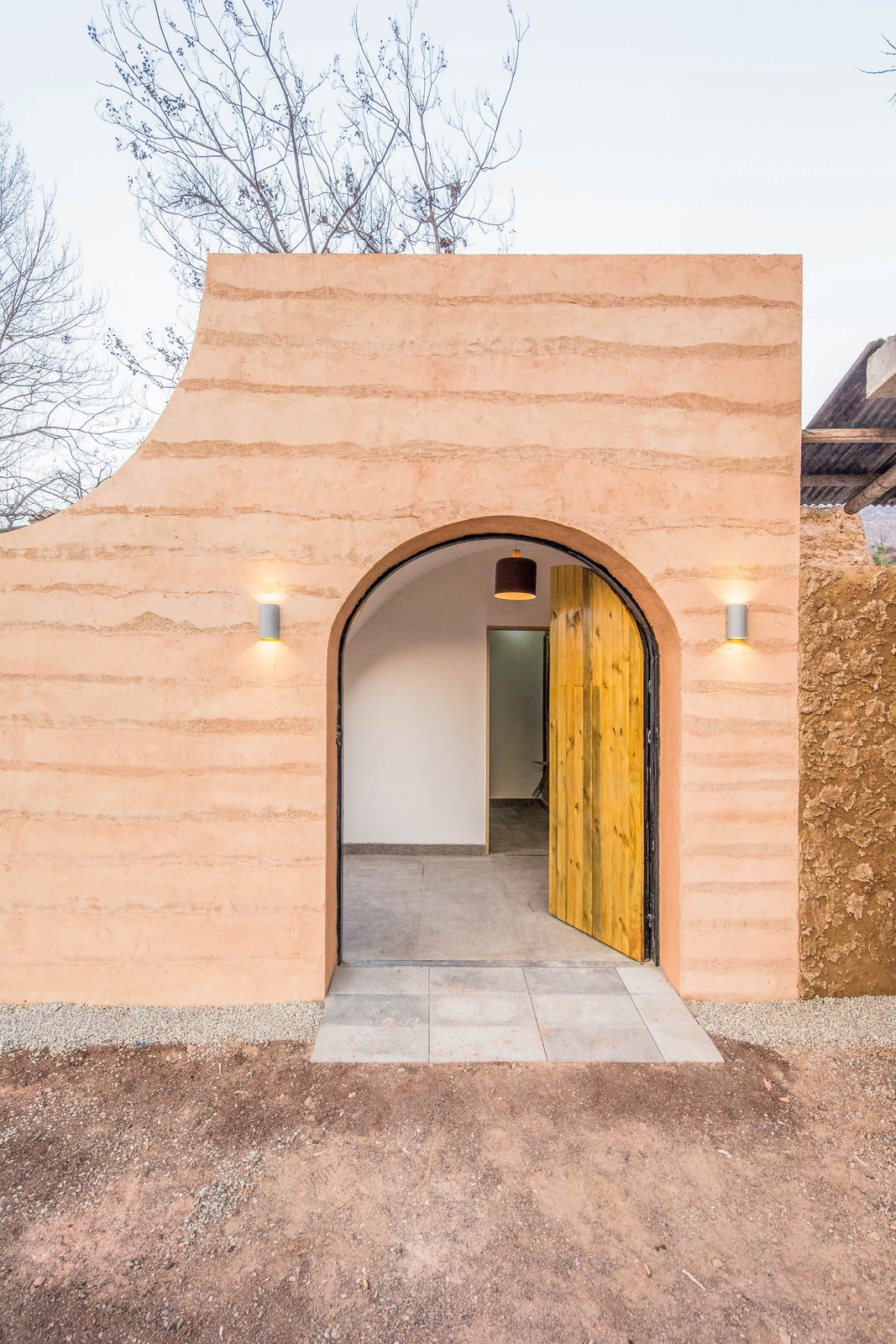 The front entrance. Tagged: Doors, Swing, Exterior, and Wood.  Best Doors Photos from An Old Cave Dwelling in Central China Is Transformed Into a Stylish Home