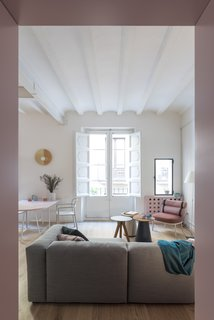 Before and After: An Ancient Barcelona Apartment Gets a Colorful, Chic Makeover - Photo 11 of 24 - The Cala and Vieques side tables are also from Kettal.