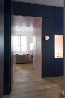 Before and After: An Ancient Barcelona Apartment Gets a Colorful, Chic Makeover - Photo 5 of 24 - In the entryway, light is provided by a minimalist glass globe, and through another outlet that peeks into the living room.