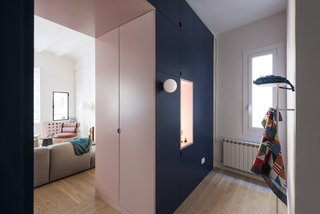 Before and After: An Ancient Barcelona Apartment Gets a Colorful, Chic Makeover - Photo 7 of 24 - A cut-out pink doorway connects the living area to the entrance, while hiding the closet doors on both sides.