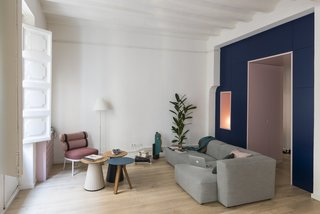 Before and After: An Ancient Barcelona Apartment Gets a Colorful, Chic Makeover - Photo 8 of 24 - The living area is now nice and bright, and outfitted with a careful selection of furniture, such as a Mags sofa by HAY and a Roll Club Chair from Kettal.