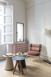Before and After: An Ancient Barcelona Apartment Gets a Colorful, Chic Makeover - Photo 12 of 24 - A small side window in the living room that was previously boarded up is now re-opened above the dotted bespoke radiator cover.