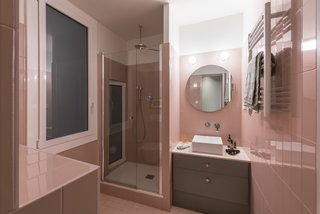 Before and After: An Ancient Barcelona Apartment Gets a Colorful, Chic Makeover - Photo 21 of 24 - The guest bathroom picks up on the pink lacquered that runs throughout the apartment.