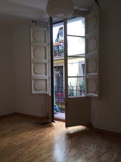 Before and After: An Ancient Barcelona Apartment Gets a Colorful, Chic Makeover - Photo 2 of 24 - The large windows in the living room.