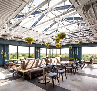 A Former Strip Club Transforms Into a Snazzy Boutique Hotel - Photo 10 of 11 -  The dining area enjoys elevated panoramic views of the city.