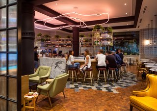 A Former Strip Club Transforms Into a Snazzy Boutique Hotel - Photo 3 of 11 - Both the cafe and bar were envisioned to serve as a social hub for hotel guests, as well as the surrounding community.