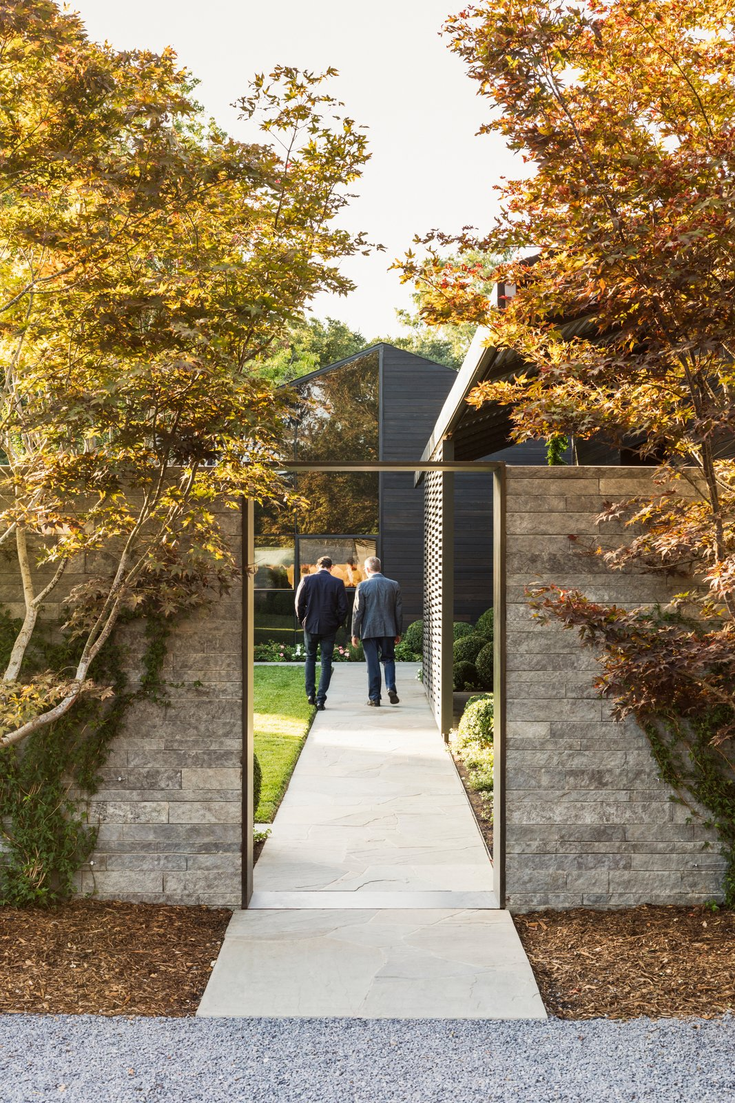 Arriving at The French Laundry, guests now begin their experience through a sequence of new garden spaces. Tagged: Exterior, Wood Siding Material, Stone Siding Material, and Glass Siding Material.  Best Photos from A Look Inside The French Laundry's Stunning $10M Renovation