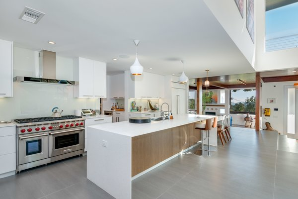 The updated open kitchen features state of the art appliances.