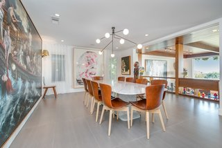 A Renovated Harry Gesner–Designed Midcentury in L.A. Wants $9.4M - Photo 4 of 15 - The dining area overlooks the sunken living room and benefits from natural light.