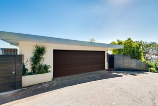 A Renovated Harry Gesner–Designed Midcentury in L.A. Wants $9.4M - Photo 1 of 15 - The facade offers a classic, streamlined midcentury profile. The property has been fully updated and is a Full Creston smart home.