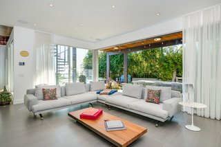 A Renovated Harry Gesner–Designed Midcentury in L.A. Wants $9.4M - Photo 6 of 15 - The den opens up to the pool area, enabling Southern California indoor/outdoor living.