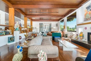 A Renovated Harry Gesner–Designed Midcentury in L.A. Wants $9.4M - Photo 3 of 15 - The bright and airy living room is a visual study of vertical and horizontal forms and features a stunning redwood ceiling.