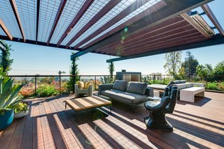 A Renovated Harry Gesner–Designed Midcentury in L.A. Wants $9.4M - Photo 12 of 15 - The cantilevered Managris wood roof deck also features anEcosmart fireplace and built-in heaters.